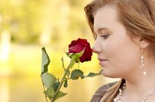 Free Young Woman With A Rose Stock Photo - 20462390