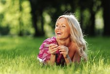 Free Blonde Lying On Green Grass Royalty Free Stock Image - 20462416