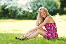 Free Blonde Sitting On Green Grass Royalty Free Stock Photo - 20462435
