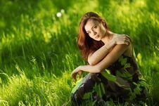 Free Brunette Sitting On Green Grass Stock Photos - 20462473