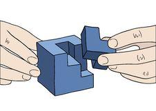 Human Hands Assembling Blue Cube Stock Image