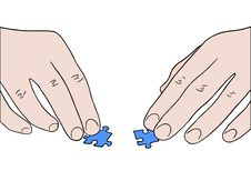 Human Hands Assembling Two Puzzle Pieces Stock Photography