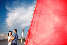 Couple Under The Red Sail Royalty Free Stock Photos