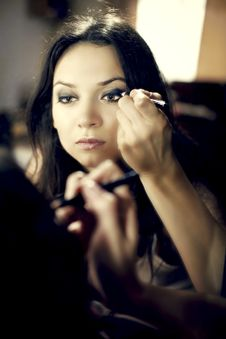 Free Beautiful Young Woman Looking In Mirror Paint Eyes Stock Image - 20470991