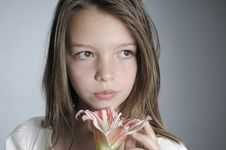 Free Adolescent Smelling Flower Royalty Free Stock Images - 20474419