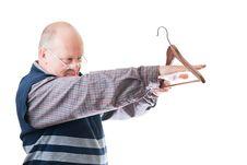 Man In Glasses Measures Cloth Hanger
