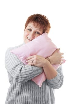 Free Happy Woman Hugs Pink Pillow Royalty Free Stock Photography - 20476037