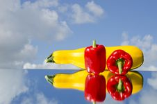 Two Red Peppers And Courgette On Mirror Royalty Free Stock Photo