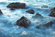 Blue-tonned Stones In Sea Royalty Free Stock Image