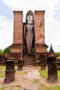 Free Standing Buddha Statue Behind Pillars Vertical Royalty Free Stock Photos - 20480408