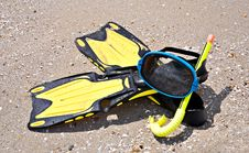 Yellow Flippers And Swimming Mask On Sea Beach Royalty Free Stock Photo