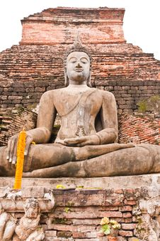 Buddha Statue In Front Of Pagoda Vertical Stock Photo