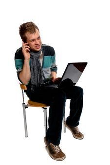 Young Man With Laptop And Mobile Phone Royalty Free Stock Photo