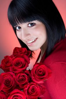 Free Young Girl Is Holding A Bouquet Of  Red Roses Stock Photos - 20483043
