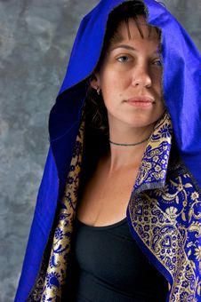 Free Young Woman In Blue And Gold Cape Royalty Free Stock Photo - 20493145
