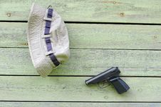 Free Hat And Pistol On The Wall Stock Photos - 20494563
