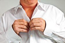 Man Closing His Shirt Stock Images