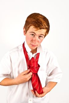 Free Teenager  Binding His Red Tie Stock Photography - 20498322