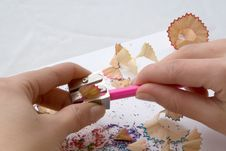 Free Girl S Hand While Sharpening A Pink Pencil Stock Images - 2050834