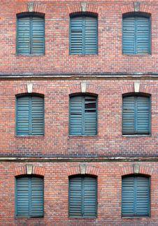 Free Nice Brickfasade With Blue Windows. Royalty Free Stock Photo - 2051745