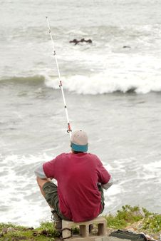 A Man Fishing In The Surf Along The California Coast Stock Image