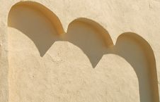 Free A Stucco Wall With Three Arches Casting Shadows Stock Image - 2056071