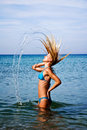 Free A Girl Splashing The Sea Water With Her Hair Stock Image - 20507781