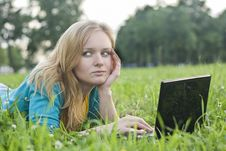 Free Pretty Woman With Laptop On The Green Grass Stock Photos - 20501253