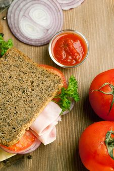Fresh Sandwich With Ham, Onion And Tomato Stock Photos