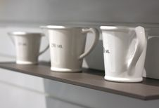 Measuring Cups On The Shelf. Royalty Free Stock Image