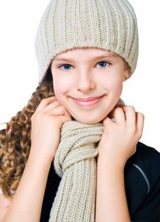 Little Girl In Cap And Scarf Stock Photography