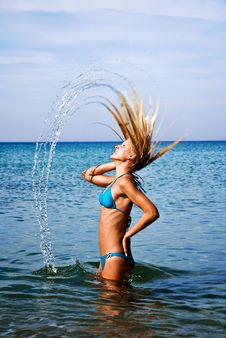 A Girl Splashing The Sea Water With Her Hair Stock Image