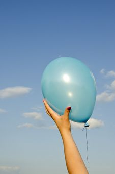 Free Girl Hand Holding Azure Balloon Stock Photo - 20509360