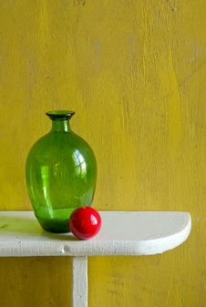 Still-life With Bottle And Red Ball Stock Photography