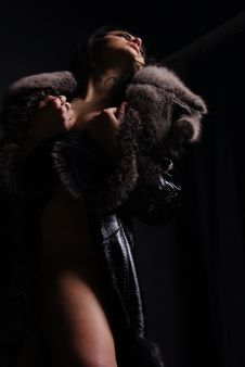 Naked Girl Is In A Fur Coat Royalty Free Stock Photo