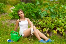Young Woman In Kitchen-garden Royalty Free Stock Photography