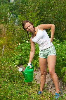 Free Young Woman In Kitchen-garden Stock Images - 20510914