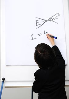 Free Genius Little Boy Writting E=mc2 Stock Photo - 20513690