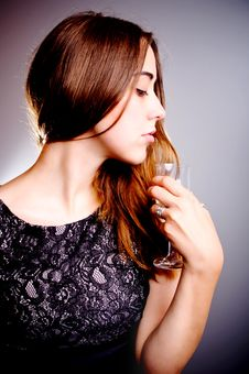 Free Young Beautiful Woman Drinks Wine Stock Photography - 20516862