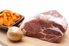 Raw Pig Roast With Onion Stock Photos