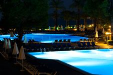 Free Hotel And Resort Swimming Pool At Night Stock Photography - 20517882