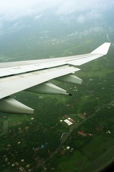Free Aeroplane Wings Over Green Landscape Stock Photography - 20517912