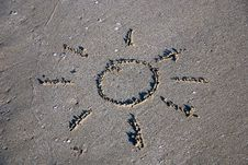 Free Sun Outline On The Wet Sand Stock Photography - 20518842