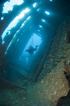 Free Divers Exploring A Large Shipwreck Stock Image - 20519031