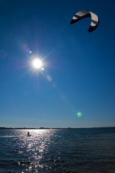 Kitesurfer On The Sea Against The Sun Stock Photo