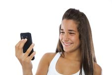 Free Cute Teenager Smiling With A Mobile Phone Royalty Free Stock Images - 20519829