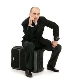 Free Businessman Sitting On His Luggage Royalty Free Stock Photos - 20521858