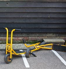 Free Yellow Scooters In A School Yard Stock Photo - 20527450
