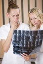 Free Women Doctors Reading X-RAY Scans Stock Photos - 20538543