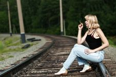 Free Sexy Woman Seating On Railway And Smoking Cigaret Royalty Free Stock Image - 20531736